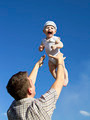 Father tossing baby in the air - PhotoDune Item for Sale