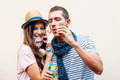 Beautiful young couple blowing soap bubbles. - PhotoDune Item for Sale