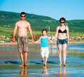 Beautiful family on the beach - PhotoDune Item for Sale