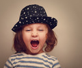 Angry shouting kid girl with open mouth. Closeup vintage portrait - PhotoDune Item for Sale