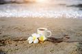 Coffee on the beach and frangipani flower. - PhotoDune Item for Sale