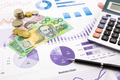 australia currency on graphs, financial planning and expense report background - PhotoDune Item for Sale