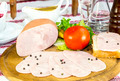 ham on the table in a restaurant with vegetables and sauce - PhotoDune Item for Sale