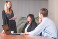 Young attractive businesswoman makes presentation for colleagues in office - PhotoDune Item for Sale