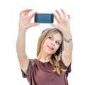 beautiful woman looking at a smart phone and taking photo - PhotoDune Item for Sale
