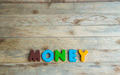 Colorful wooden word Money on wooden floor3 - PhotoDune Item for Sale