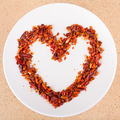 Hot chili peppers arranged in heart shape - PhotoDune Item for Sale