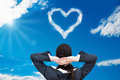 Businesswoman Looking At Heart Shaped Cloud In Sky - PhotoDune Item for Sale