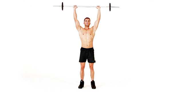 Handsome Muscular Man Doing Exercises