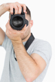 Closeup of photographer with photographic camera over white background - PhotoDune Item for Sale