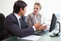 Male and female executives in meeting at office