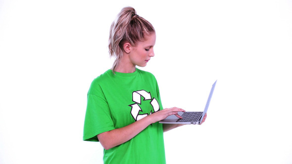 Young Blonde Environmental Activist Using Notebook