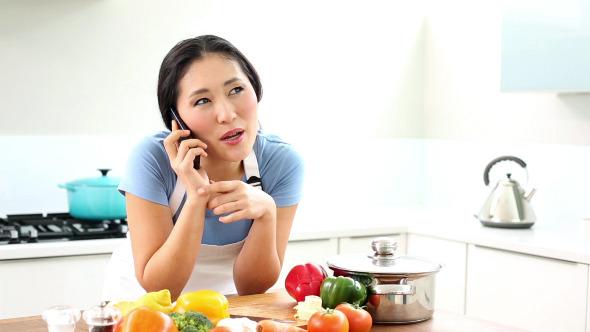 Happy Woman Preparing Dinner