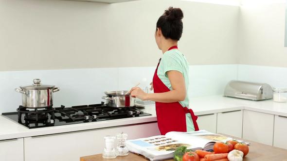 Smiling Woman Preparing Dinner