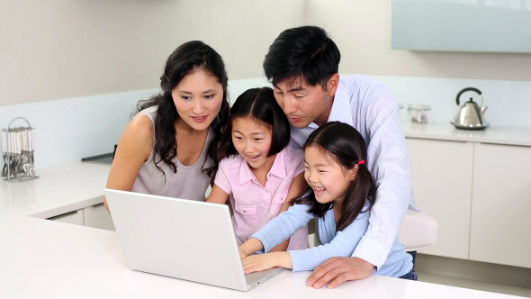 Happy Family Using Laptop Together