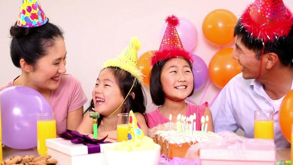 Happy Family Celebrating A Birthday 1