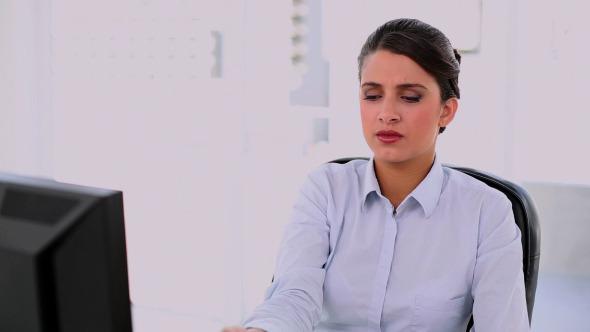 Annoyed Beautiful Businesswoman Using Her Phone