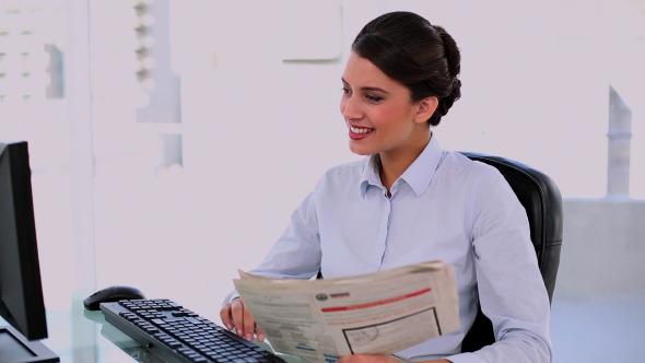 Thoughtful Beautiful Businesswoman Using Computer