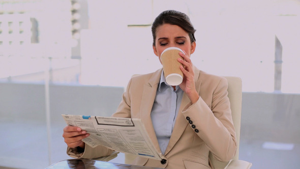 Relaxed Beautiful Businesswoman Drinking Coffee