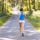 Sporty young woman runner running on the road in forest - PhotoDune Item for Sale