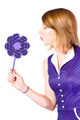 Pretty pin up girl playing with purple pinwheel - PhotoDune Item for Sale