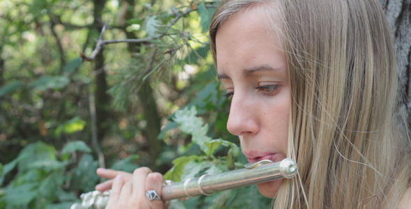 Girl Playing The Flute 3