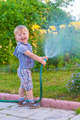 boy with hose - PhotoDune Item for Sale