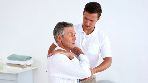 Stressed Businessman Getting His Shoulders Aligned