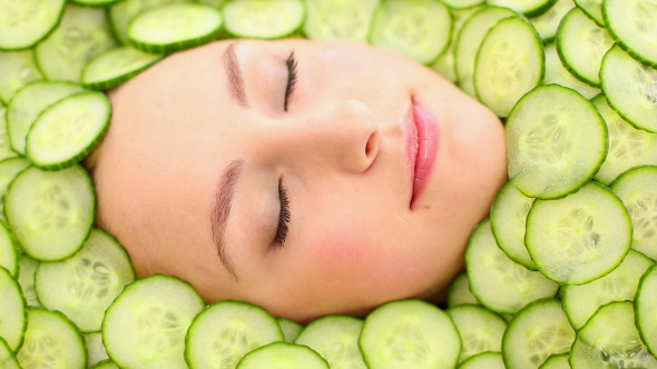Natural Womans Face Surrounded By Cucumber 2