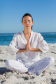 Woman practicing yoga at the beach on a summers day - PhotoDune Item for Sale