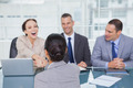 Business team interviewing young apllicant in bright office - PhotoDune Item for Sale