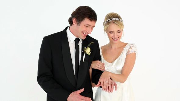 Newlyweds Admiring Their Wedding Rings