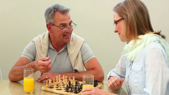 Mature Couple Playing Chess Together 2