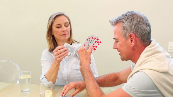 Mature Couple Playing Cards Together 1