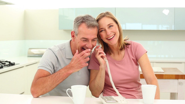Mature Couple Talking On The Phone