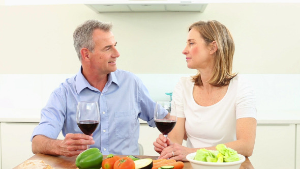 Mature Couple Drinking Red Wine Together 1