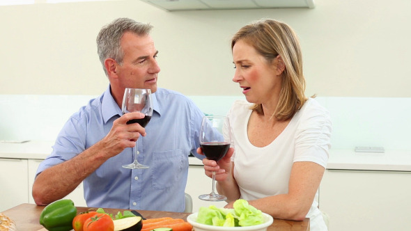 Mature Couple Drinking Red Wine Together 2