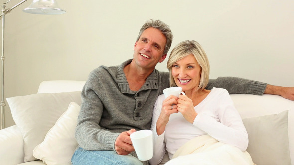 Couple Drinking Coffee On The Couch 1