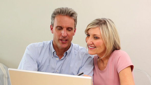 Mature Couple Shopping Online Together