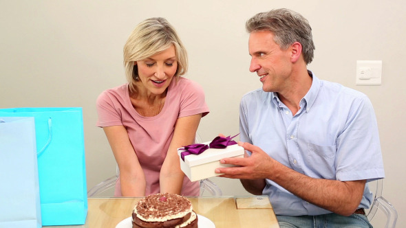 Man Giving His Wife Her Birthday Present