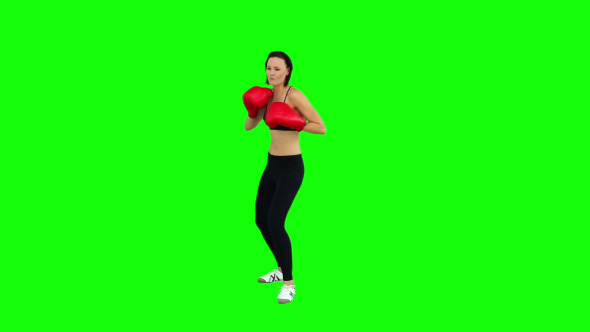 Fit Brunette Boxing With Red Gloves 2