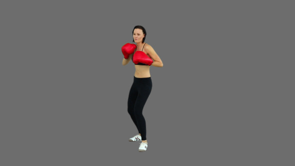 Fit Brunette Boxing With Red Gloves 3