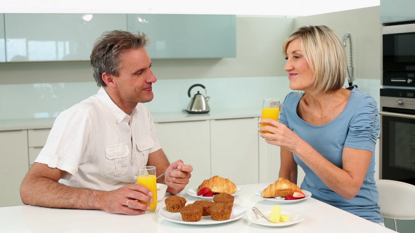 Mature Couple Having A Romantic Breakfast Together