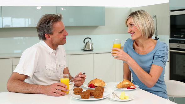 Mature Couple Enjoying A Romantic Breakfast
