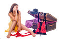 Beautiful woman sits and thinks of the forthcoming trip near open suitcase - PhotoDune Item for Sale