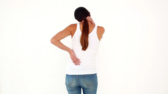 Slim Model In Jeans With Back And Neck Ache