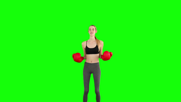 Slim Model Cheering With Red Boxing Gloves