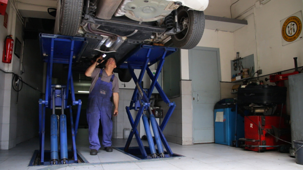Car Repair Looking for Damage 3