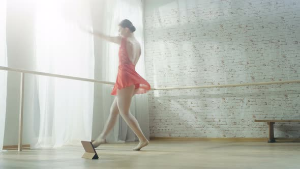 VideoHive Young Beautiful Contemporary Dancer in Red Tutu Dress Turns on Music on Her Tablet 19473651