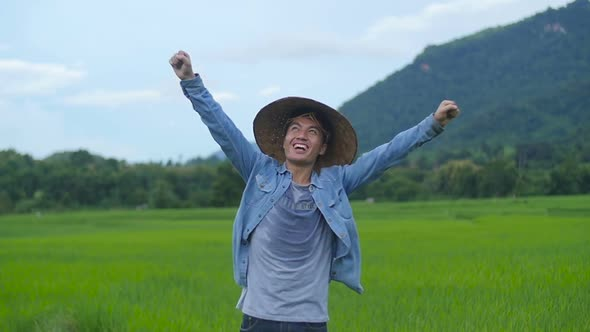 Download Farmer Celebrating Success On His Rice Fields nulled download